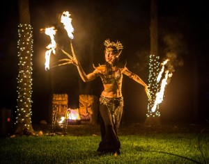 Sage Fire Dancing at a Thai Theme benefit party for Academy for Global Studies